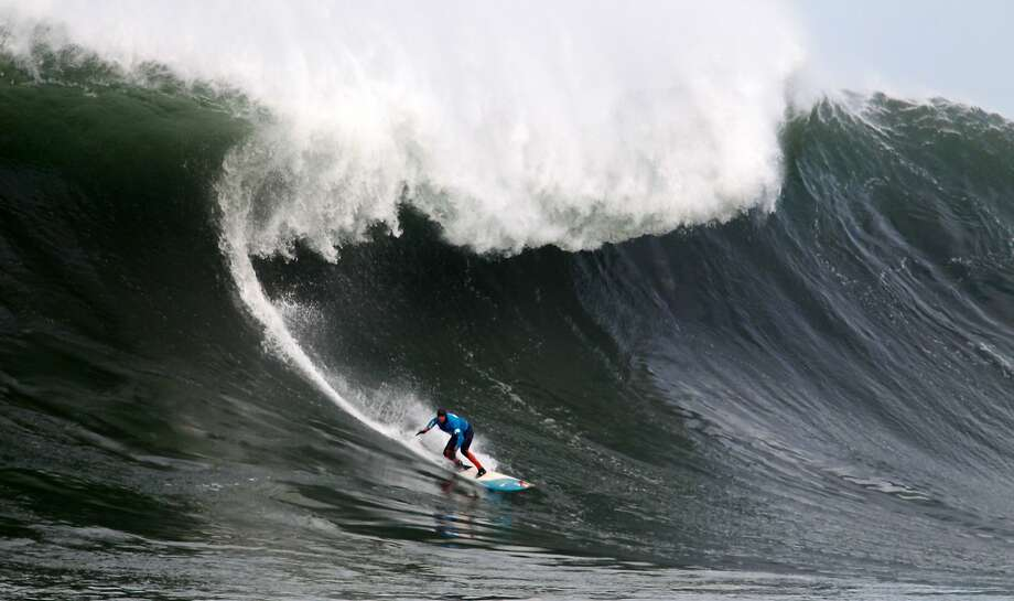 Peter Mel rides a wave during the first round of the Maverick's Invitational surf contest in Half Moon Bay, Calif., on Friday, Jan. 24, 2014. Photo: Mathew Sumner, Special To The Chronicle