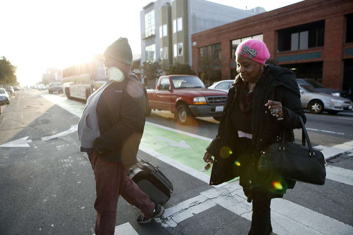 Phyllis Trammell, 72, and her developmentally disabled son Louis Williams, 42, walk through the SOMA district ats they head for the St. Vincent de Paul shelter in hopes of finding a bed for the night, in San Francisco, CA, Thursday, January 23, 2014. Phyllis and her son Louis have recently become homeless after losing their hotel in Sacramento and have been living on the streets of San Francisco for the last three weeks.