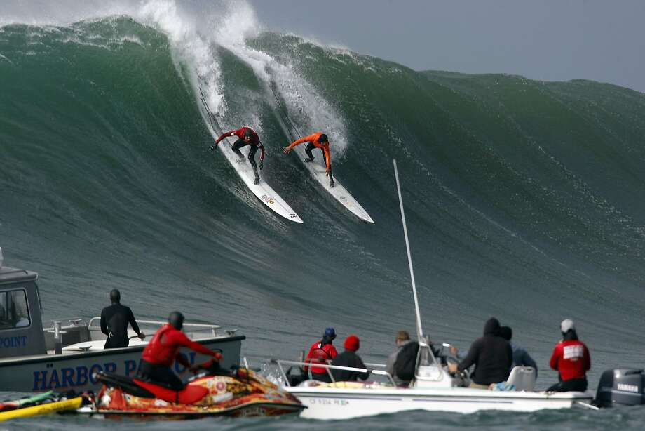 Grant Baker, right, and Rusty Long both drop into a wave during Semi final round 2 of the 2014 Maverick's Invitational surf contest held in Half Moon Bay, CA, Friday, January 24, 2014. Photo: Michael Short, The Chronicle