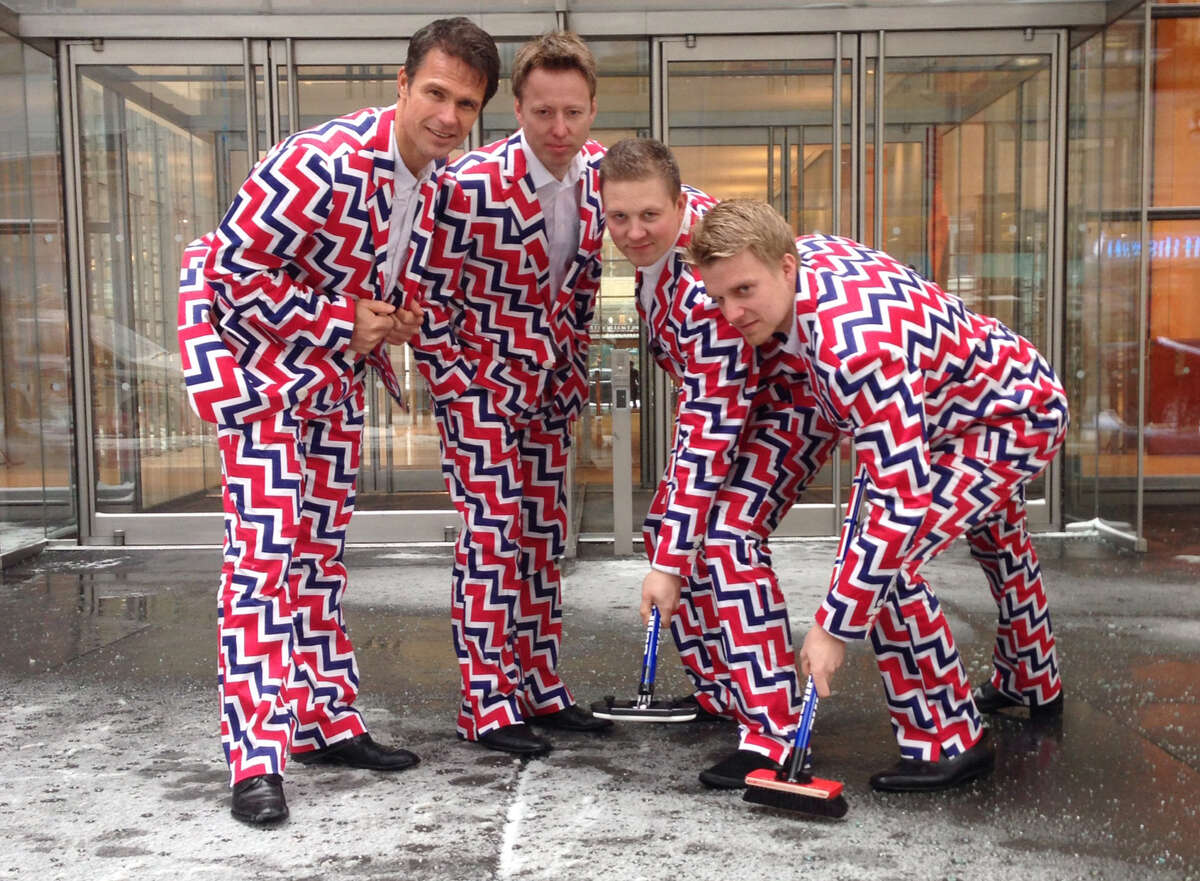 Thomas Ulsrud, from left, Torger Nergaard, Christoffer Svae and Haavard Vad Petersson, members of Norway's Men's Olympic Curling Team, modeling their Sochi 2014 suits, say their wild uniforms help take the edge off during competitions.