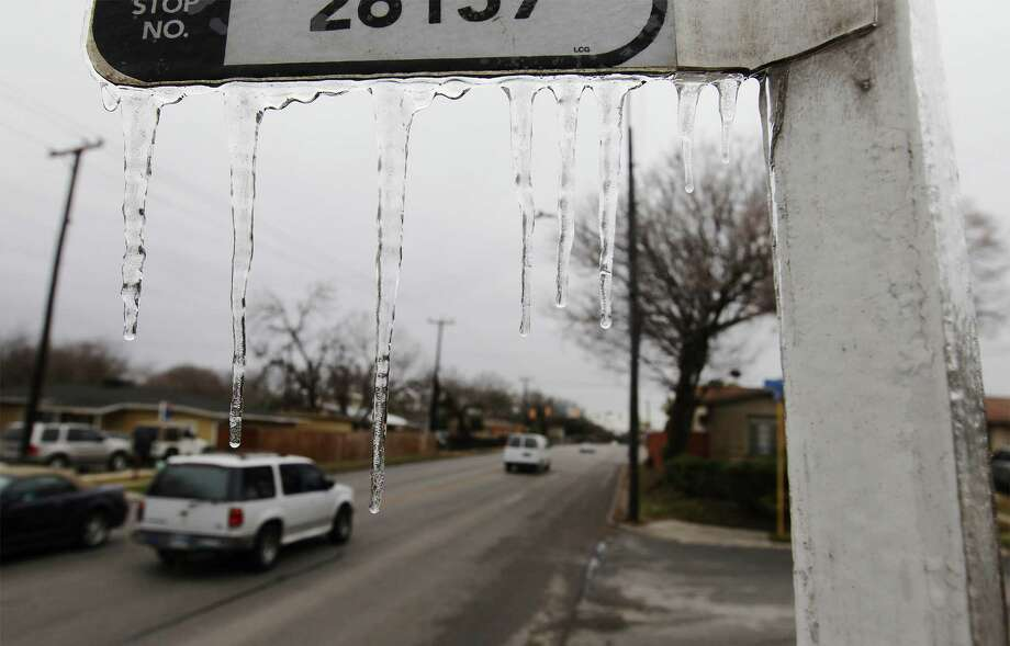 Ice crystals hang from a bus stop sign along Vance Jackson Road after an overnight winter storm on Friday, Jan. 24, 2014. The storm caused icing on roadways and forced some parts of highways to be temporarily shut down. Photo: Kin Man Hui, San Antonio Express-News / ©2013 San Antonio Express-News