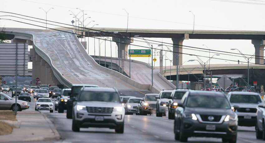 Traffic is directed to the access road as fly over ramps at 1604 and 281 remain closed during the morning rush hour on January 17, 2018