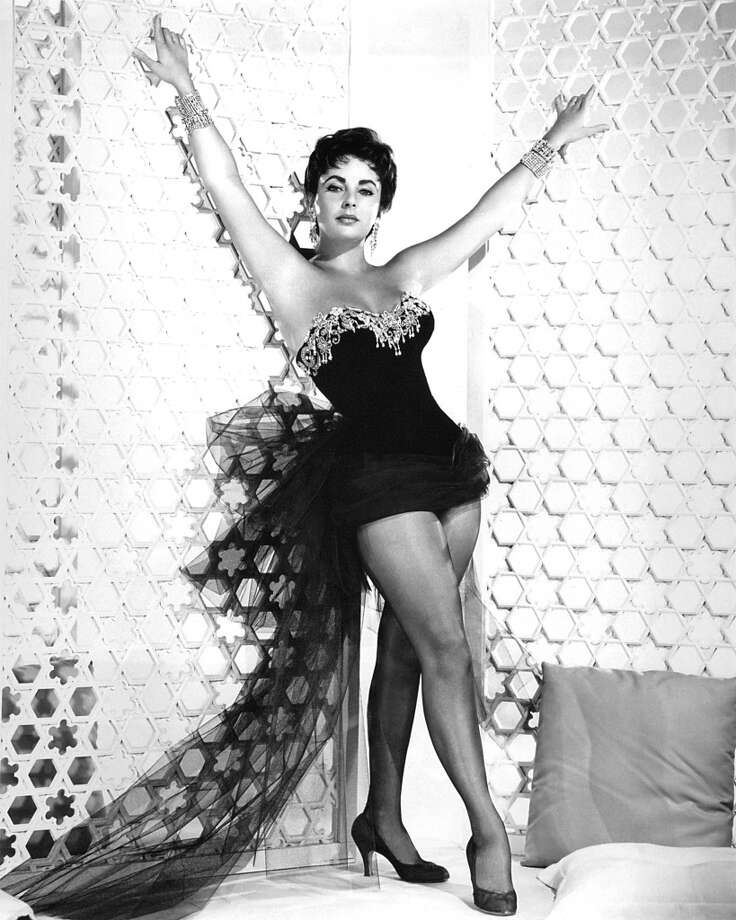 British-born American actress Elizabeth Taylor (1932 - 2011) in a showgirl outfit, circa 1955. Photo: Silver Screen Collection, Getty Images