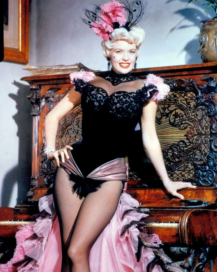 American actress Jayne Mansfield (1933 - 1967) wearing a showgirl outfit in a promotional portrait for 'The Sheriff of Fractured Jaw', directed by Raoul Walsh, 1958. Photo: Silver Screen Collection, Getty Images