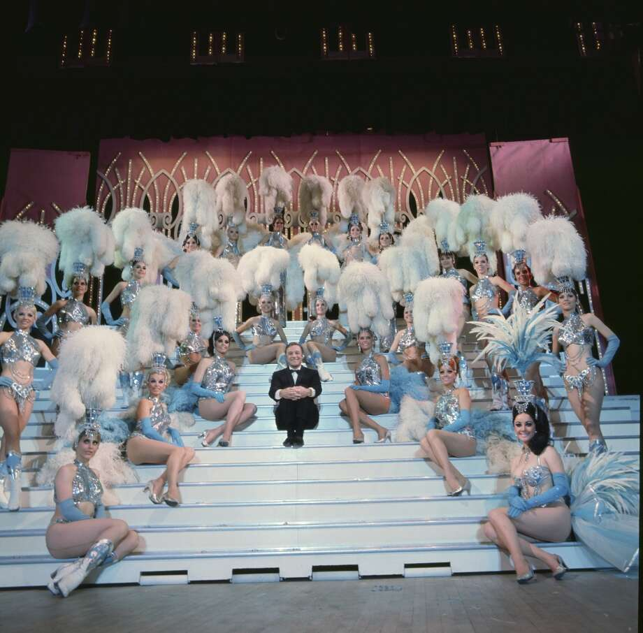 GENE KELLY'S WONDERFUL WORLD OF GIRLS -- Aired 01/14/1970 -- Pictured: Gene Kelly (center) with the Folies Bergere Showgirls. Photo: NBC, NBC Via Getty Images