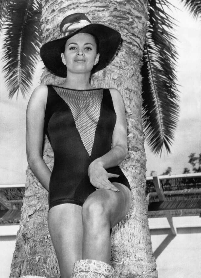 Folies Bergere showgirl, Lisa Medford, shows off her new peek-a-boo air-cooled bathing suit, Las Vegas, Nevada, April 16, 1966. In 1957 she became the first woman to go topless on stage in Las Vagas. Photo: Underwood Archives, Getty Images