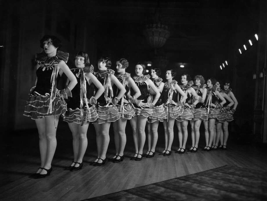 circa 1930:  A line of chorus girls in the cabaret at the Piccadilly Hotel, London. Photo: General Photographic Agency, Getty Images