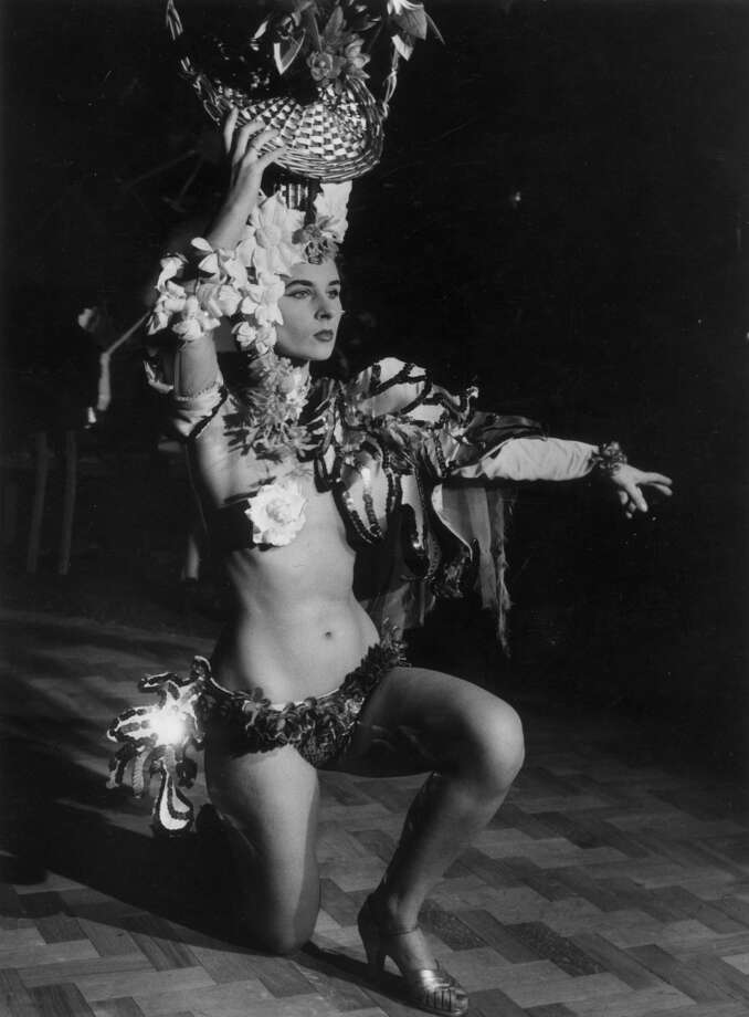1st January 1956:  A showgirl dancing at the Eve nightclub on Regent Street, London. Original Publication: Picture Post - British Industries Fair - pub. 1956 Photo: Thurston Hopkins, Getty Images