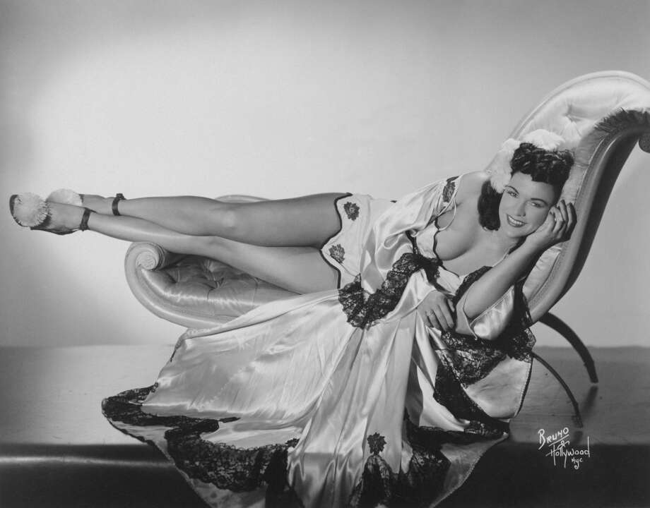 Burlesque dancer Mary Mack reclining on a chaise longue, circa 1950. Photo: Archive Photos, Getty Images