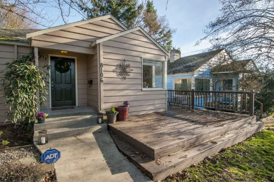 We'll start with the mid-priced home on our tour, 8106 35th Ave. S.W., which is listed for $269,900. The 780-square-foot house, built in 1940, has two bedrooms, one bathroom and a deck that wraps around the front and side. An open house is scheduled for 1 p.m. to 4 p.m. on Sunday. Photo: Courtesy Jennifer Nelson,  Windermere Real Estate