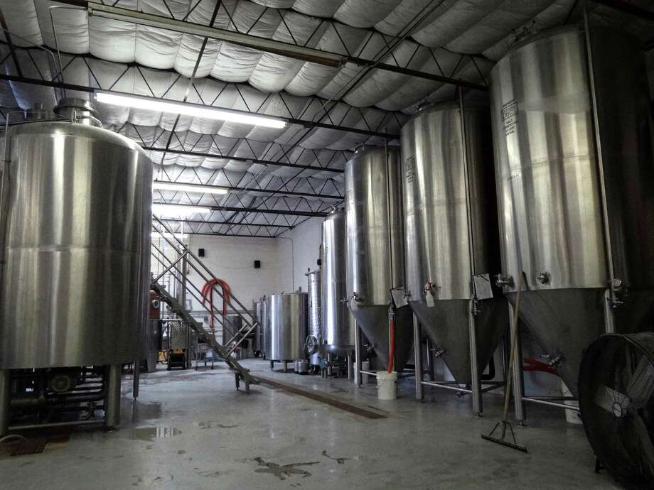 The main brewing system at Ranger Creek Brewing is on the left, while fermentation tanks stand on the right at Ranger Creek Brewing and Distilling on Saturday, Oct. 8, 2011.  Photo: BILLY CALZADA, SAN ANTONIO EXPRESS-NEWS / gcalzada@express-news.net
