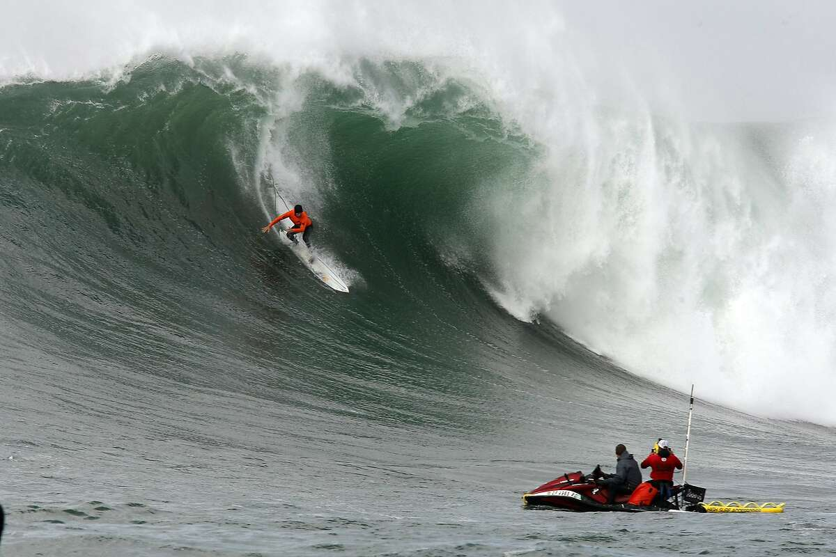 Grant Baker rides out of a wave during Semi final round 2 of the 2014 Maverick's Invitational surf contest held in Half Moon Bay, CA, Friday, January 24, 2014.