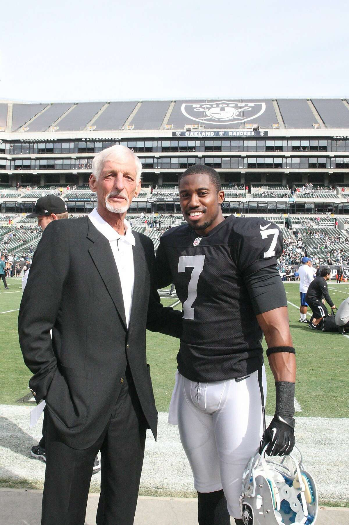 Ray Guy, shown here with current Raiders punter Marquette King before the Oakland-Philadelphia game on Nov. 3, will find out next Saturday (Feb. 1) if he has been chosen the first punter in the NFL Hall of Fame.