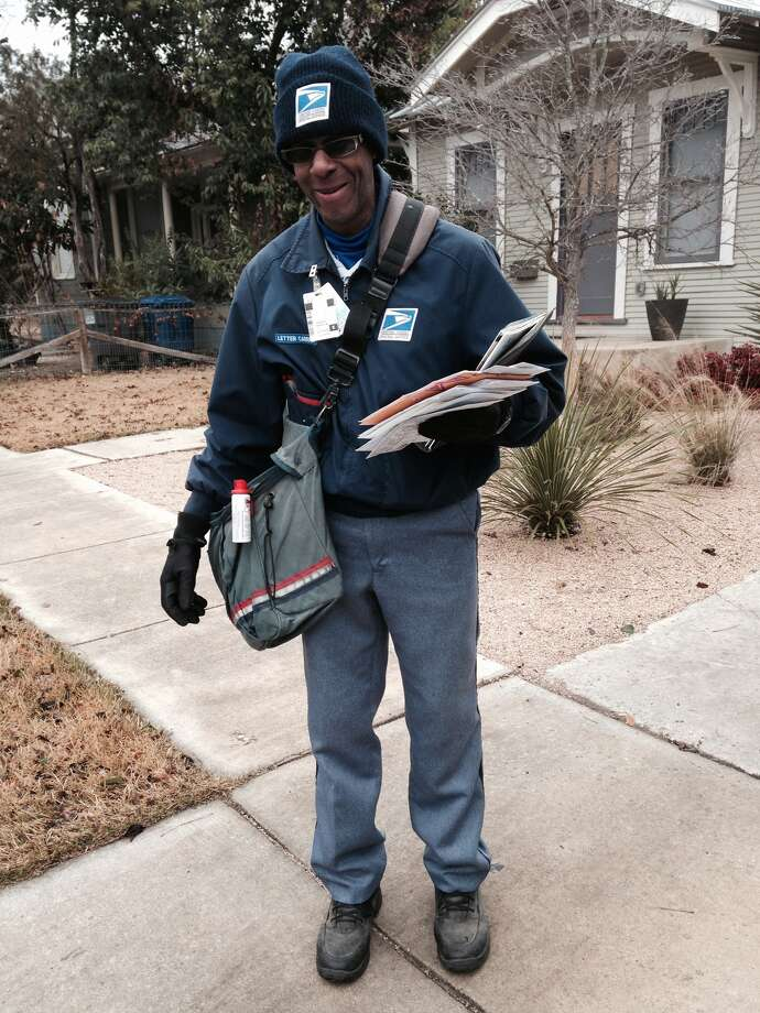 "Joshua Spann Jr. proves that neither snow, rain or sleet can keep him from his appointed rounds on E. Guenther St. in King William as he delivers the mail. And he bundled up for the wintry blast on Friday, Jan. 24, 2014, wearing three layers of clothing, two pairs of socks and heavy gloves. ""I'd wear two pair of gloves it's so cold but then I couldn't handle the mail,"" he said. Photo: Michael Quintanilla/San Antonio Express-News"