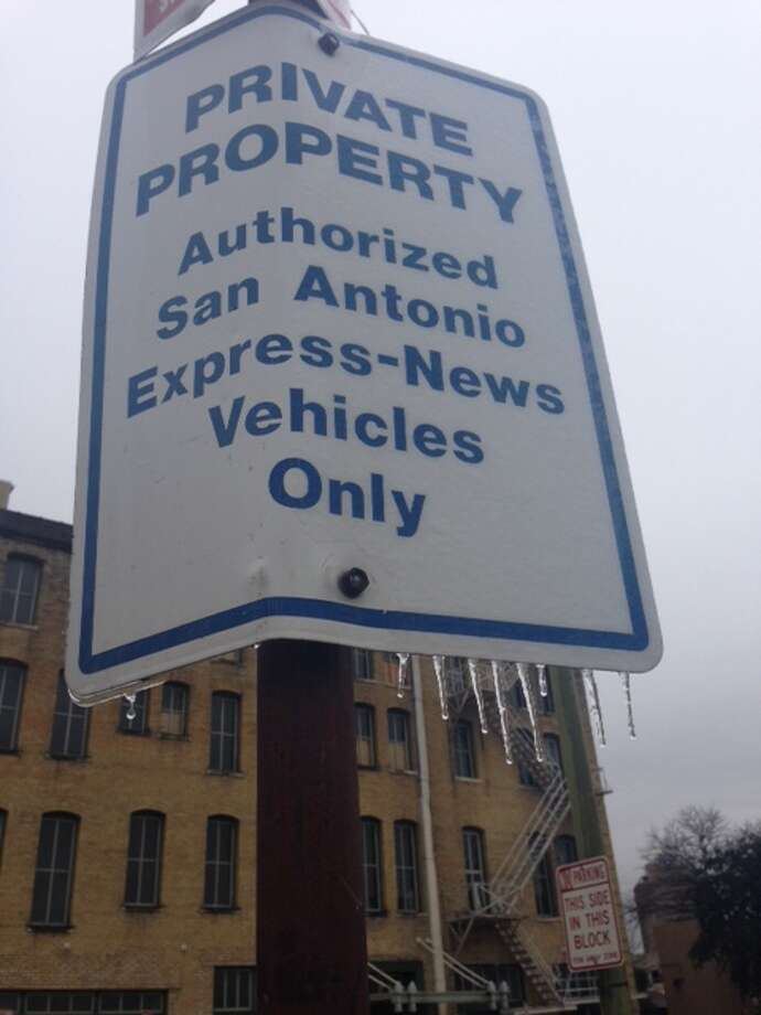 Ice began to melt by 1 p.m. Friday, Jan. 24, 2014, throughout the city, including at the Express-News parking lot on Third Avenue and Alamo Street. Photo: Rachel Benavidez/San Antonio Express-News