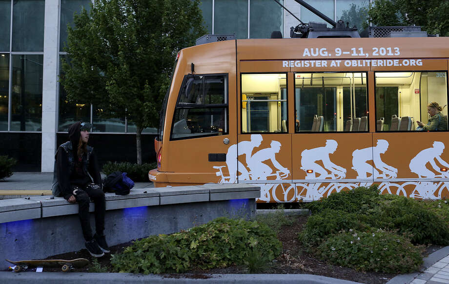 The Seattle Streetcar pulls into a station. San Antonio's planned streetcars can be the beginning of a better mass transit future. Photo: Lisa Krantz / San Antonio Express-News / San Antonio Express-News