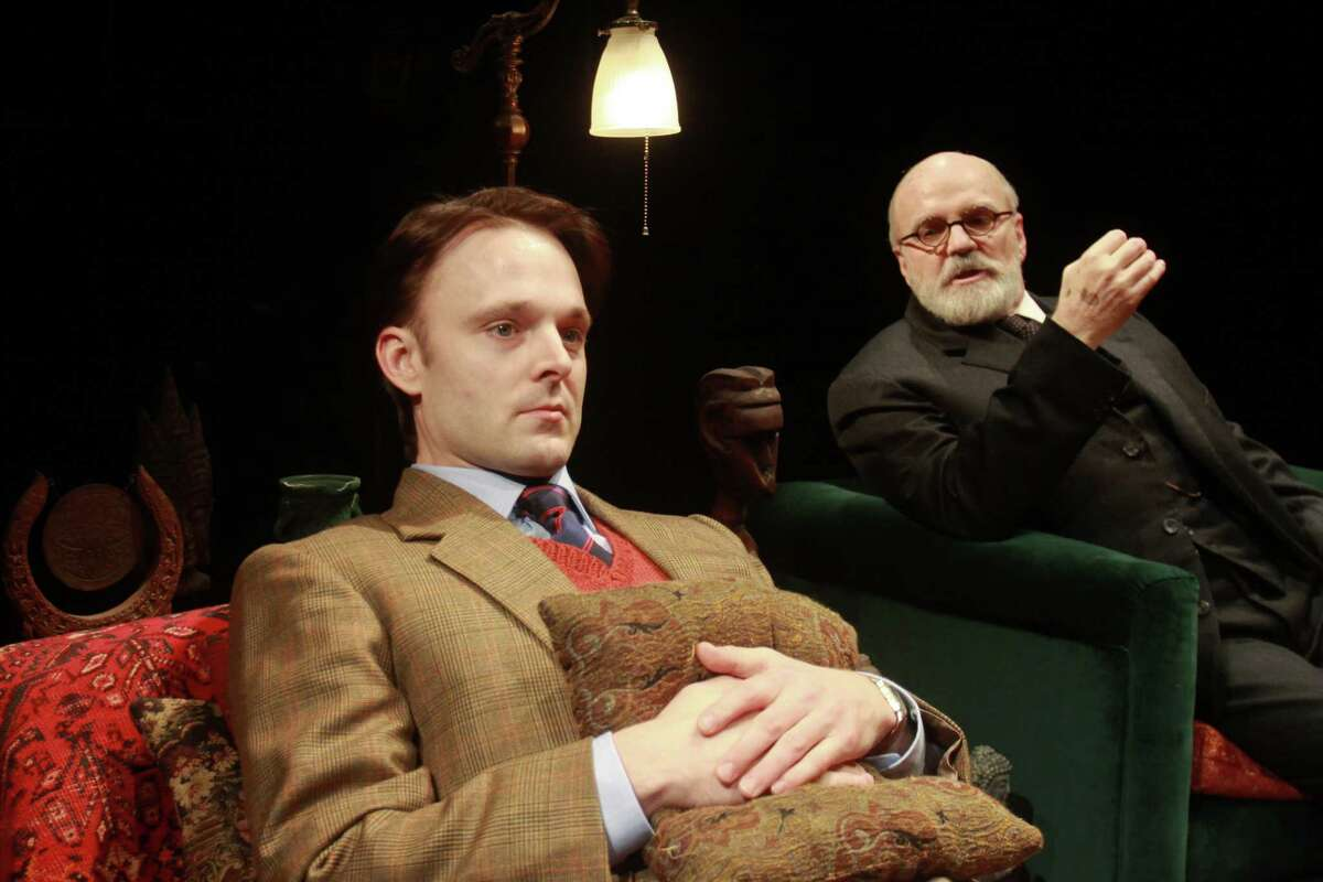 """(For the Chronicle/Gary Fountain, January 21, 2014) Jay Sullivan as C.S. Lewis, left, and James Black as Sigmund Freud, in this scene from Alley Theatre's Houston premiere of the hit off-Broadway play """"Freud's Last Session"""", a two character play imagining a meeting between pioneering psychoanalyst Sigmund Freud and author/philosopher C.S. Lewis."""