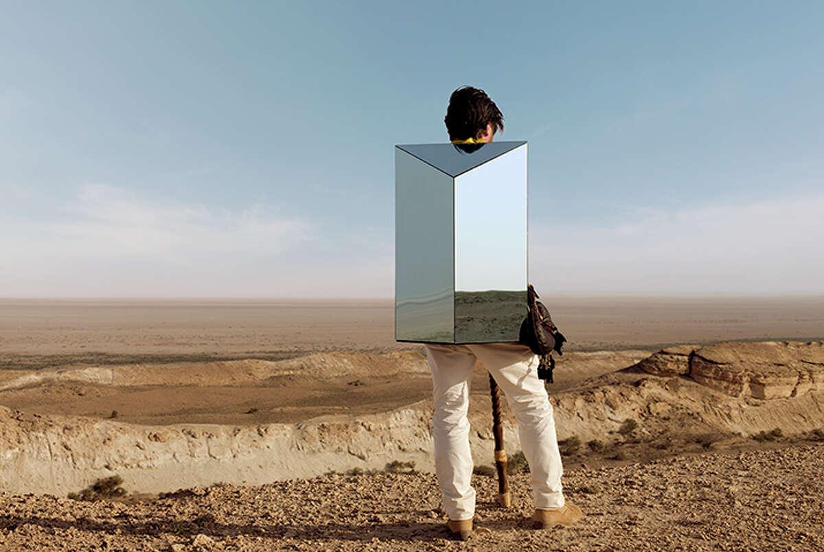 "In ""Terra Corpus,"" the wandering character wears a mirrorlike sculpture like a backpack."