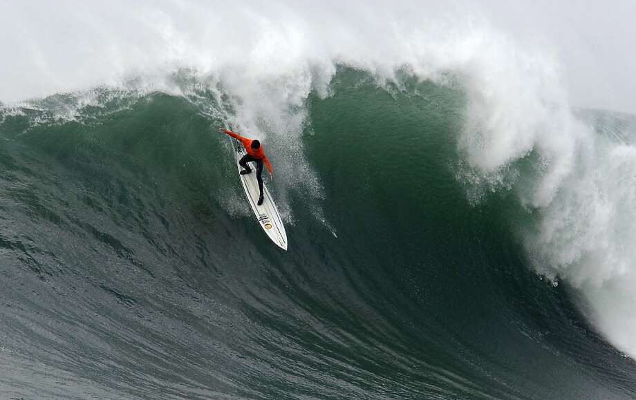 Grant Baker rides out of a wave during Semi final round 2 of the 2014 Maverick's Invitational surf contest held in Half Moon Bay, CA, Friday, January 24, 2014. Photo: Michael Short, The Chronicle