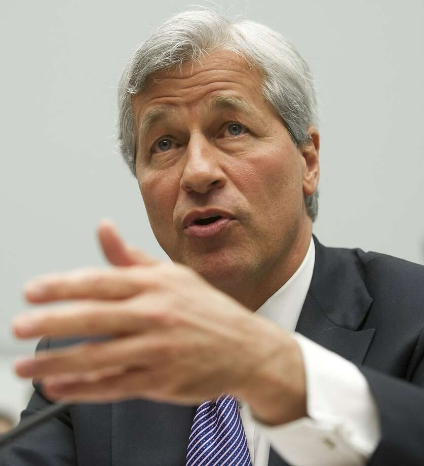 "(FILES) JPMorgan Chase Chairman and CEO Jamie Dimon testifies during a US House Financial Services Committee hearing on Capitol Hill in Washington, DC, in this June 19, 2012 file photo. Jamie Dimon, the head of JPMorgan Chase, saw his pay nearly double for 2013 -- to $20 million -- despite the bank's record legal and regulatory costs, according to a government filing on January 24, 2014.In the filing, JPMorgan said that Dimon would receive a 2013 bonus of $18.5 million worth of restricted stock to be vested over the next three years, ""tying Mr. Dimon's 2013 compensation to the company's future performance, including continued progress on the company's regulatory agenda."" The base salary for Dimon, JPMorgan's chairman and chief executive, was $1.5 million, unchanged from 2012. AFP PHOTO / Saul LOEBSAUL LOEB/AFP/Getty Images Photo: Saul Loeb, AFP/Getty Images"