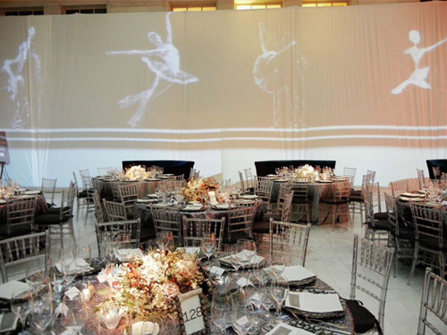 Immersive Projection Art's film of ballet dancers flashed over Benavides' tables in the North Light Court Photo: Catherine Bigelow