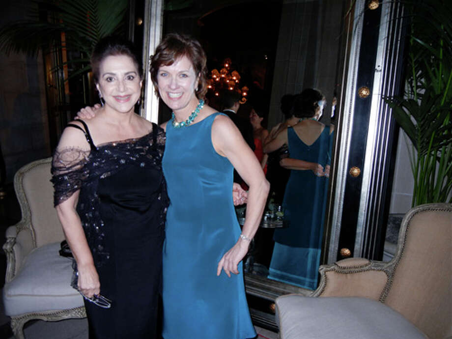 Designer Lily Samii (left) with McCall Associates exec Lee Gregory (in a Samii gown) Photo: Catherine Bigelow
