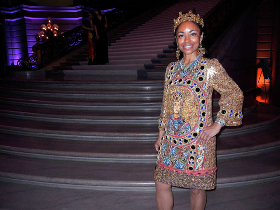 For the post-party in City Hall, Powell changed into a party queen with this Dolce & Gabbana cocktail dress and crown Photo: Catherine Bigelow