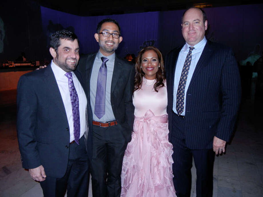 Christopher Contos (at left) with Ashok Bania, Laura Miller and her husband, Matt Herold Photo: Catherine Bigelow