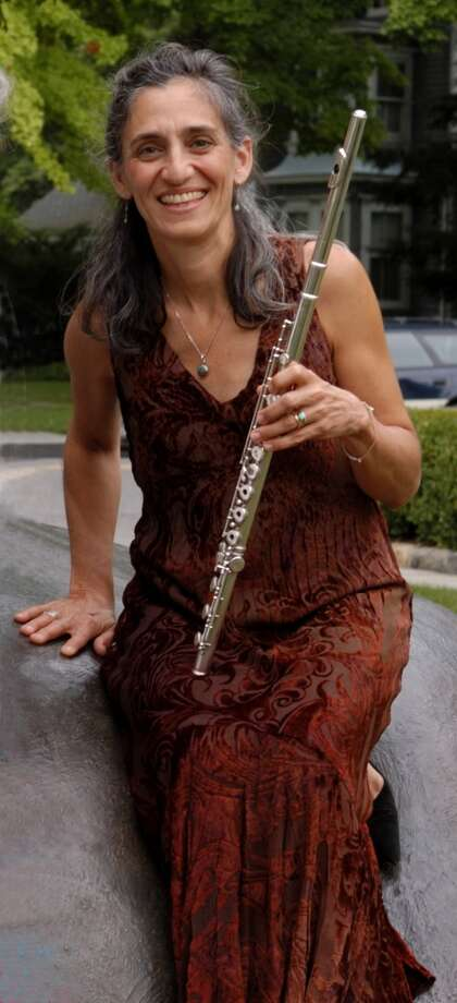 The Greenwich Symphony's performances of Jan. 25 and 26 will feature Susan Rotholz, Principal Flutist of the Orchestra, and Principal Harpist Victoria Drake, who will perform ìPhoenix Madrigal,î a composition by David Gilbert, Conductor of the Greenwich Symphony. Photo: Contributed Photo