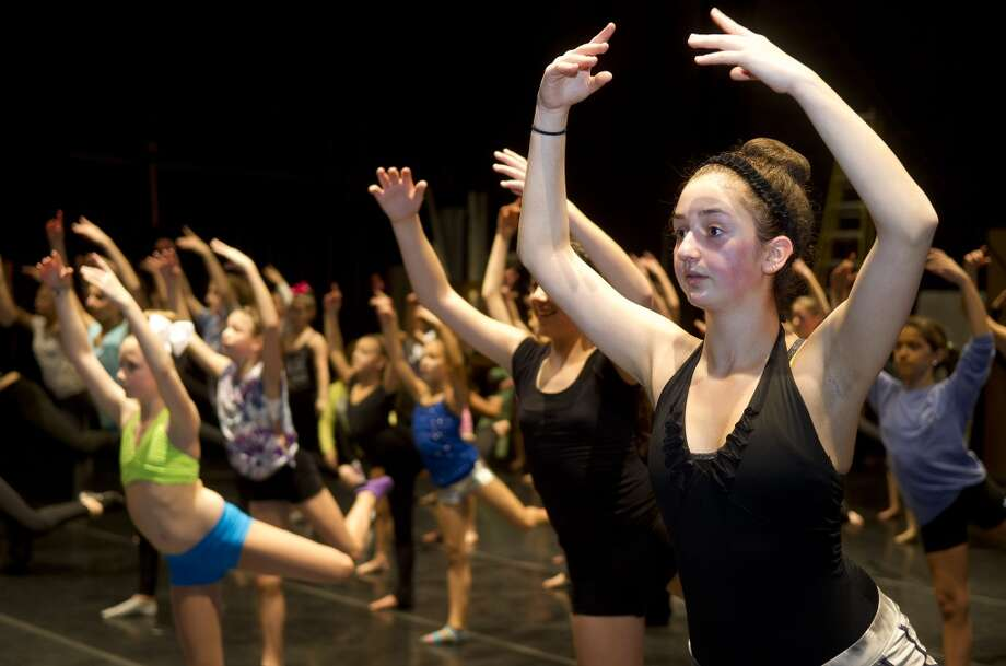 Dancers participate in the intermediate contemporary dance class during the 12th annual DanceFest at the Palace Theatre in Stamford, Conn., on Saturday, Jan. 18, 2014. The culmination of their work will be seen on stage Jan. 26, 2014 in Stamford, Conn. Photo: Lindsay Perry