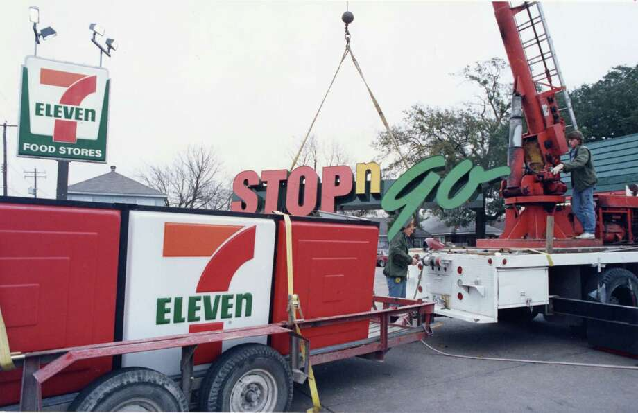 In 1988, Red Halmich, left, and Allen Hemphill install a new Stop-N-Go sign at an outgoing 7-Eleven at 2418 Yale. After a 26-year absence, the Dallas-based convenience store company is returning to the Houston area. Photo: Manuel M Chavez, HP Staff / Houston Post files
