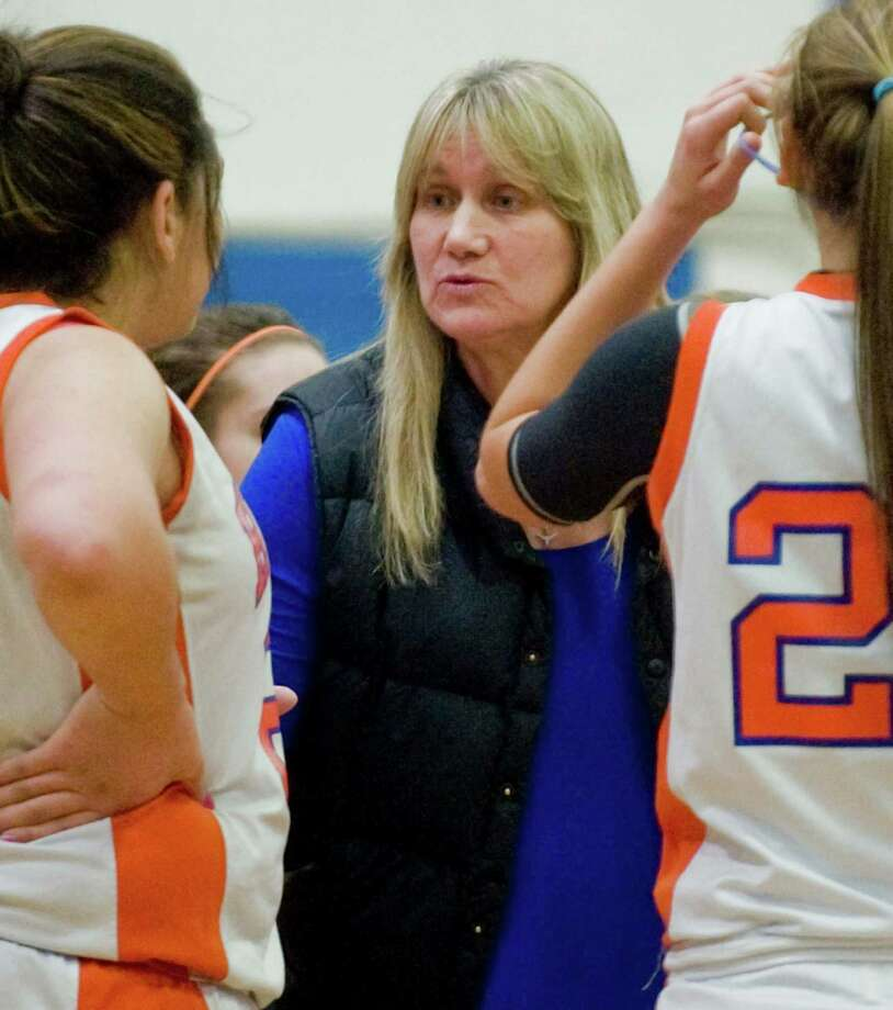 Danbury High School girls basketball head coach Jackie DiNardo talks to her players during a game against Fairfield Warde High School at Danbury. Friday, Jan. 24, 2014 Photo: Scott Mullin / The News-Times Freelance