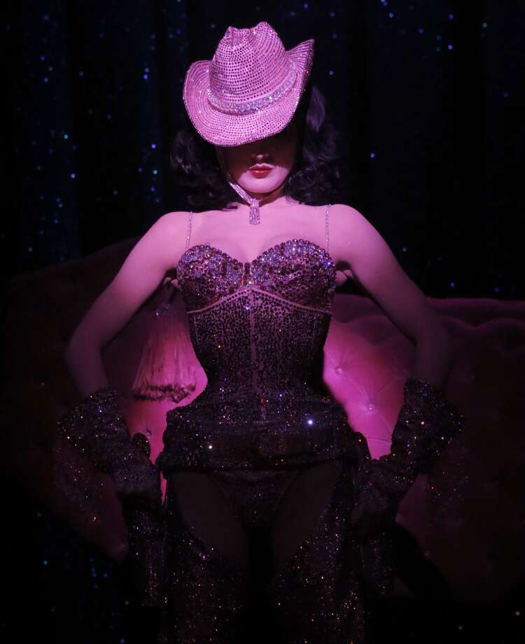 "Autumn Adamme of Dark Garden and Catherine D'lish made Dita Von Teese's pink cowgirl costume for ""Burlesque: Strip Strip Hooray!"" It is covered in thousands of pink Swarovski crystals. Photo: Todd Williamson, Associated Press"