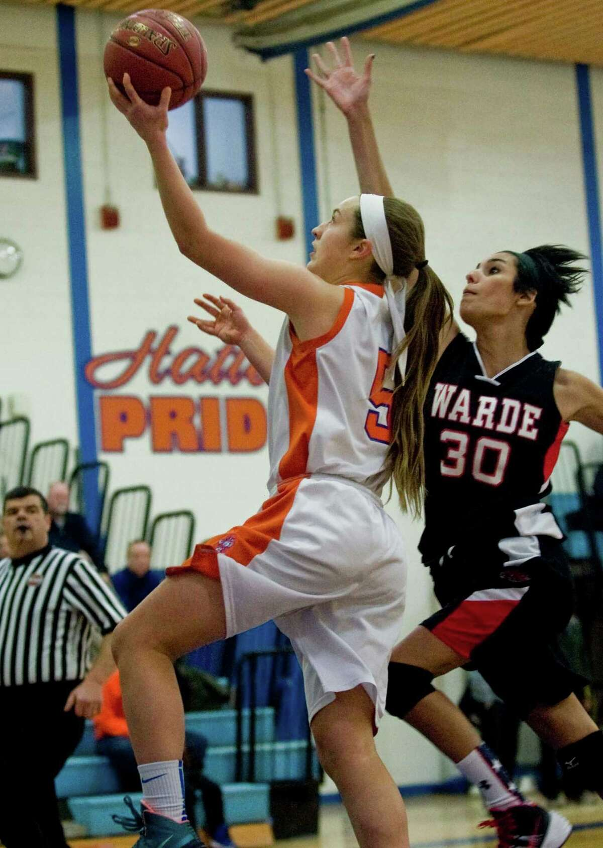 Danbury High School's Rachel Gartner goes up for the basket in a game against Fairfield Warde High School, played at Danbury. Friday, Jan. 24, 2014