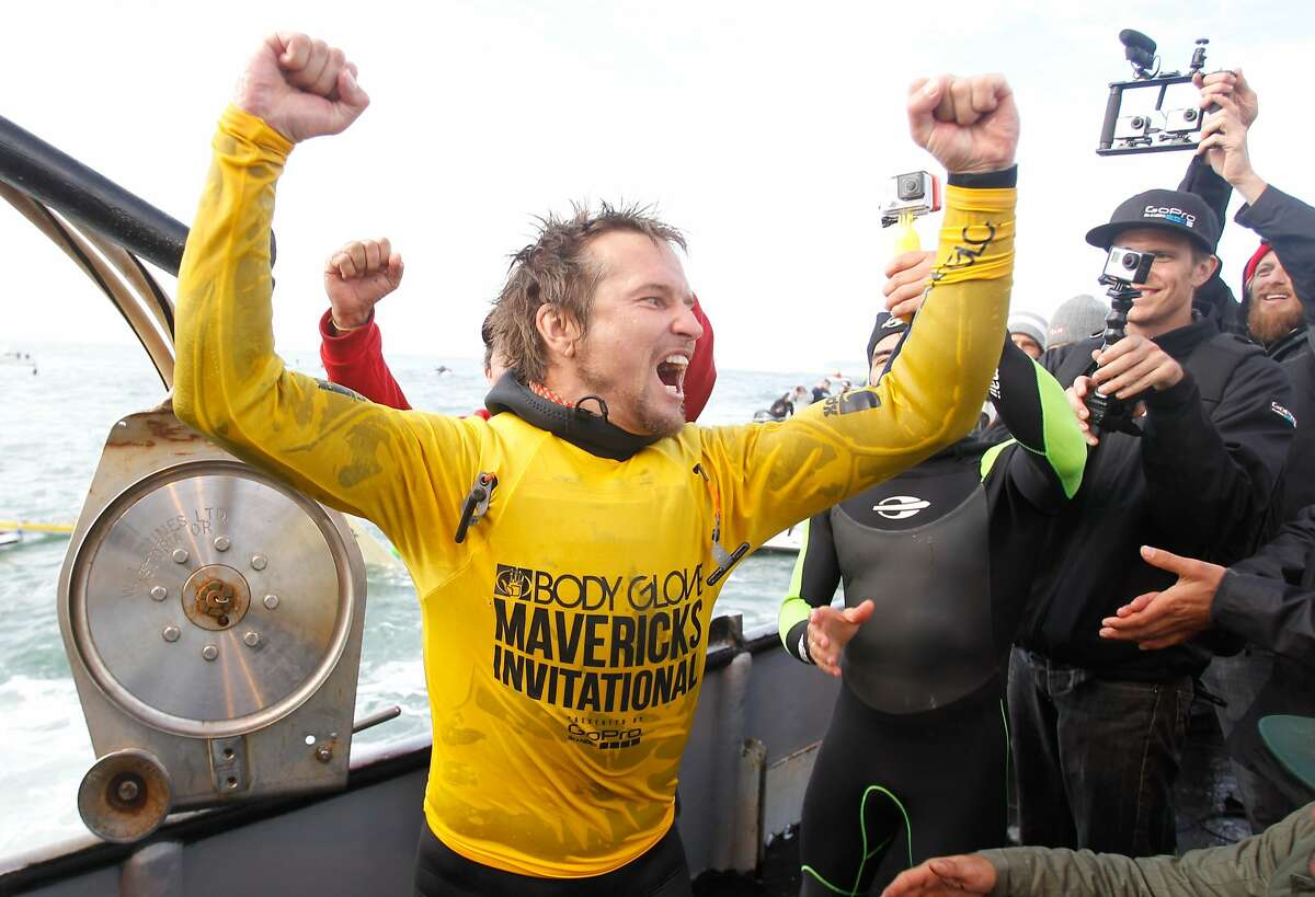Grant Baker celebrates after winning the Maverick's Invitational surf contest for his second time in Half Moon Bay, Calif., on Friday, Jan. 24, 2014.
