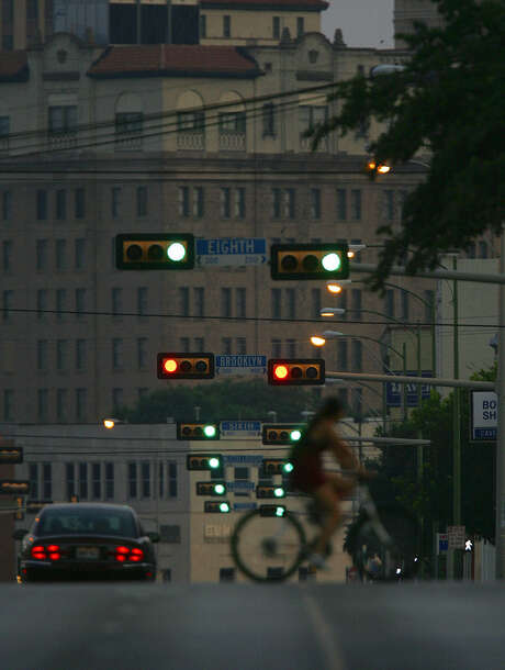 A sequence of traffic lights controls  traffic on Broadway leading into downtown. Street design and usage in San Antonio will help determine the city center's future. Photo: Express-News File Photo / SAN ANTONIO EXPRESS-NEWS