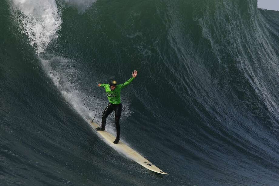 Ryan Augenstein makes the drop on a wave during the Finals of the 2014 Maverick's Invitational surf contest held in Half Moon Bay, CA, Friday, January 24, 2014. Photo: Michael Short, The Chronicle