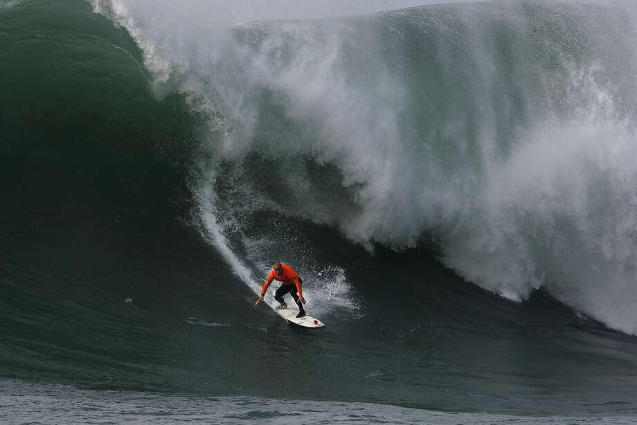 Shane Dorian drops into a wave during the Finals of the 2014 Maverick's Invitational surf contest held in Half Moon Bay, CA, Friday, January 24, 2014. Photo: Michael Short, The Chronicle