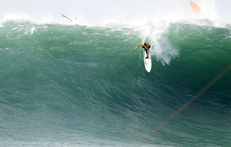 Grant Baker takes off on a wave during finals of the Maverick's Invitational surf contest in Half Moon Bay, Calif., on Friday, Jan. 24, 2014. Baker went on to win the event. Photo: Mathew Sumner, Special To The Chronicle