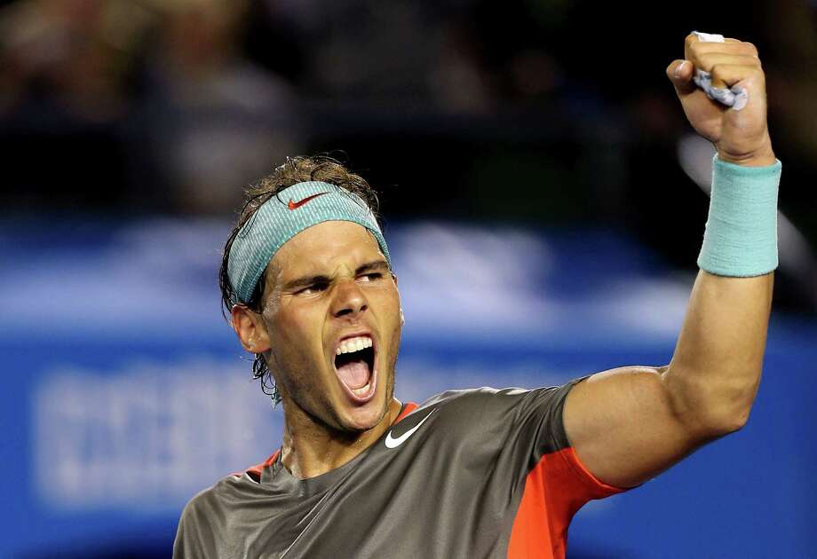 MELBOURNE, AUSTRALIA - JANUARY 24:  Rafael Nadal of Spain celebrates winning his semifinal match against Roger Federer of Switzerland during day 12 of the 2014 Australian Open at Melbourne Park on January 24, 2014 in Melbourne, Australia.  (Photo by Clive Brunskill/Getty Images) ORG XMIT: 179530024 Photo: Clive Brunskill / 2014 Getty Images