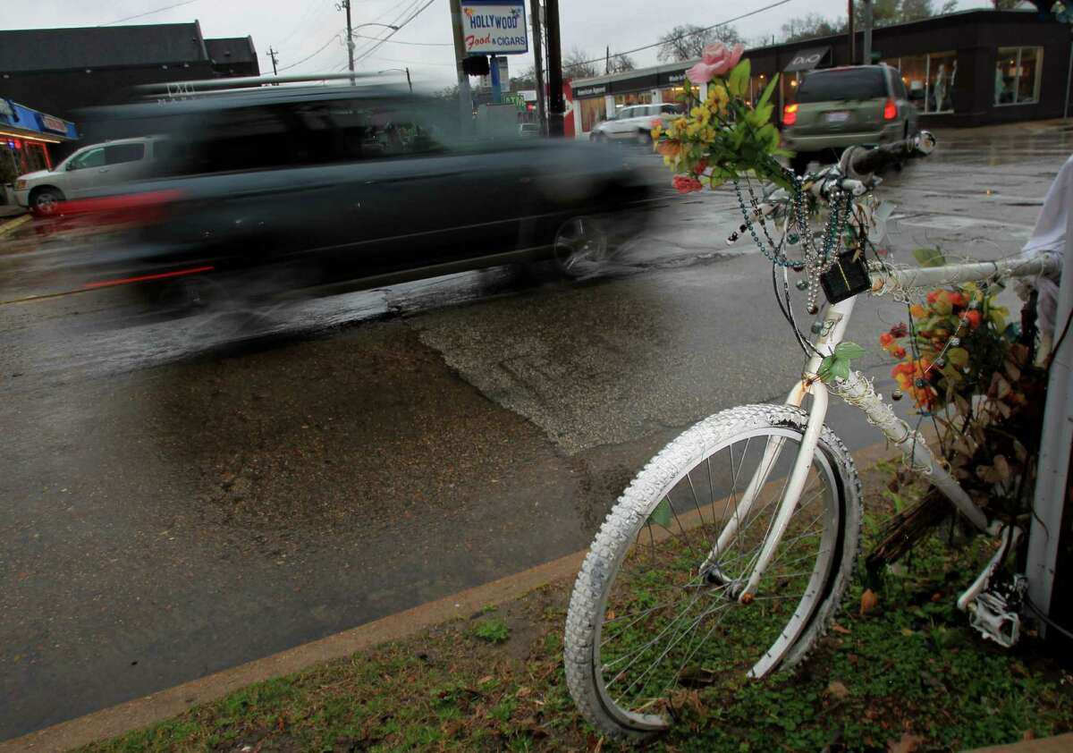 A ghost bike stands in memory of bicycle rider Leigh Boone on Dunlavy and Westheimer on Thursday, Jan. 23, 2014, in Houston.