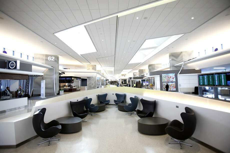 The newly renovated Boarding Area E in Terminal 3 at San Francisco International Airport features midcentury-style Egg chairs and free Wi-Fi. It opens Tuesday after Saturday's community day. Photo: Sarah Rice, Special To The Chronicle