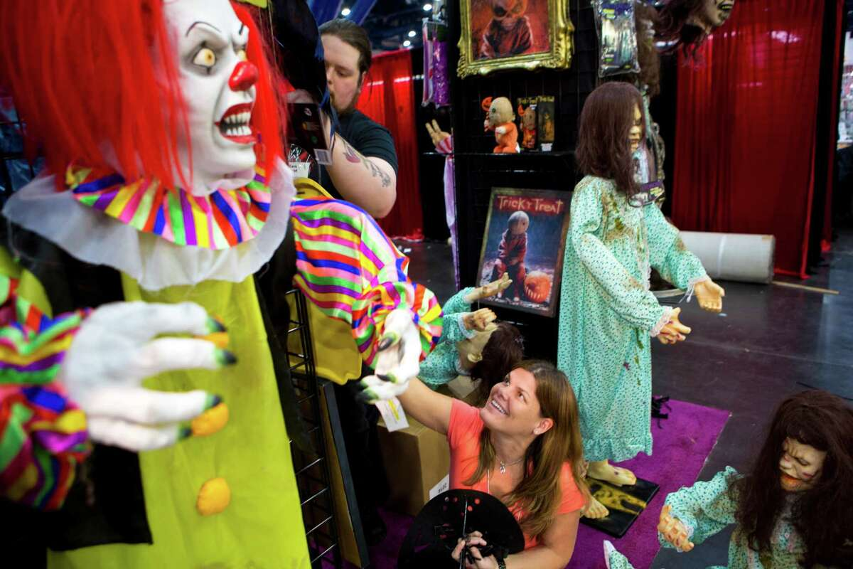 Sally Werme of Morbid Enterprise prepares the visual presentation of their booth for the first day of the 2014 Halloween and Party Expo, Friday, Jan. 24, 2014, in Houston. The show sell wholesale to retailers.
