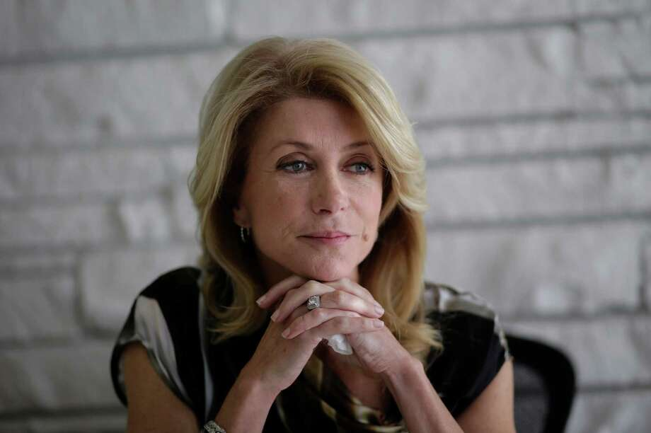 Democratic candidate for Texas governor Wendy Davis takes part in a interview, Tuesday,  Jan. 21, 2014, in Austin, Texas. Davis promised to veto a state income tax to pay for public schools and to expand where people may carry their handguns in the interview. (AP Photo/Eric Gay) Photo: Eric Gay, STF / AP