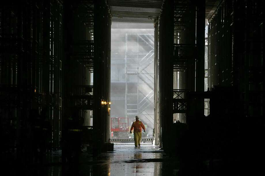 A worker walks in an area that will house the Highway 99 approach into the tunnel. Photo: JOSHUA TRUJILLO, SEATTLEPI.COM / SEATTLEPI.COM