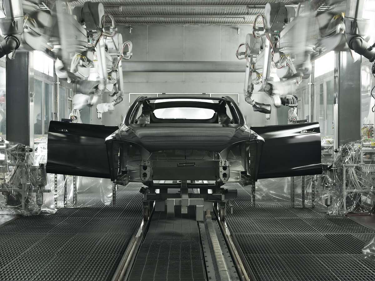 Model S sedans being built at the Tesla Motors factory in Fremont. Tesla may open a factory in China if the company?•s electric luxury cars sell well there.