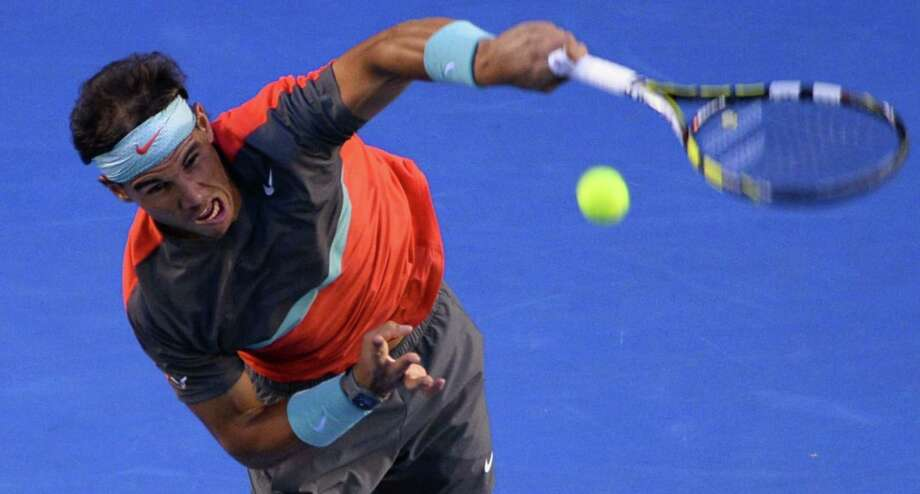 Rafael Nadal, above, cleared a big hurdle Friday night in the Australian Open semifinals by knocking off longtime nemesis Roger Federer in straight sets. Photo: WILLIAM WEST, Staff / AFP