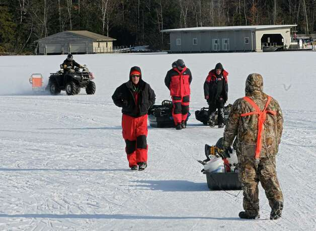 Ice fishermen pull their gear on sleds as they call it a day on Lake George Friday, Jan. 24, 2014 in Bolton Landing, N.Y.  (Lori Van Buren / Times Union) Photo: Lori Van Buren