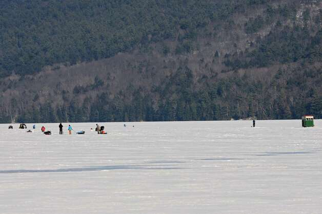 Ice fishermen are seen on Lake George Friday, Jan. 24, 2014 in Bolton Landing, N.Y.  (Lori Van Buren / Times Union) Photo: Lori Van Buren
