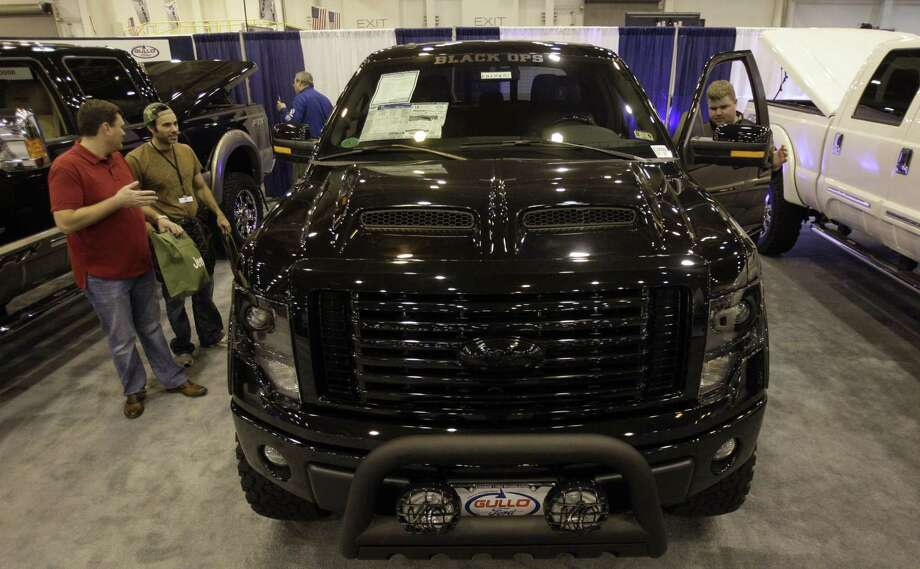 One of the head-turners at the Houston Auto Show's aftermarket expo is this Tuscany Black Ops edition, a customized Ford F-150. The aftermarket business was up 4 percent industrywide, to $31 billion, in 2012, a trade group said. Photo: Melissa Phillip / Houston Chronicle / © 2014  Houston Chronicle